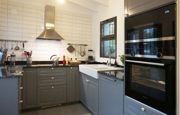 Kitchen with induction hub, oven, microwave, dishwasher